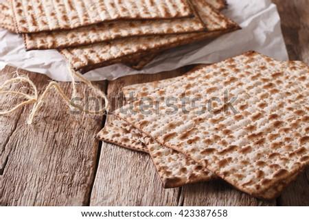 traditional Jewish kosher matzo for Passover macro on a wooden table. horizontal - stock photo