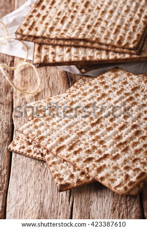 traditional Jewish kosher matzo for Passover macro on a wooden table. Vertical - stock photo