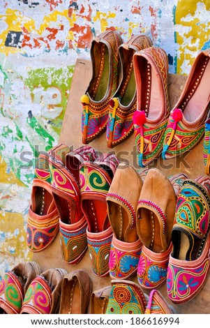 Traditional juttis at an Indian street vendor's stall - stock photo