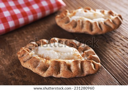 traditional karelian pie over wooden background - stock photo