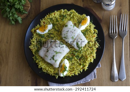 Traditional kedgeree dish on a plate - stock photo