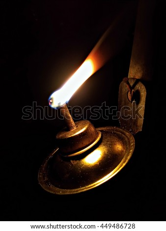 traditional kerosene lamp lights up at night