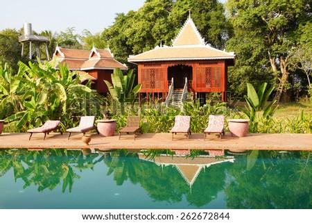 Traditional Khmer house and swimming pool, Rajabori Villas, Ko Trong Island, Cambodia - stock photo