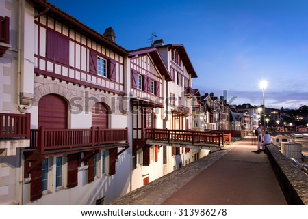 Traditional labourdine houses of Saint de Luz at night, Basque Country, France - stock photo