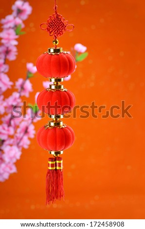 Traditional lantern and peach blossom on a festive background. - stock photo