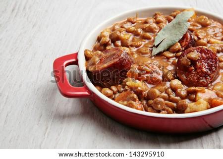 traditional lentils and spanish chorizo stew - stock photo