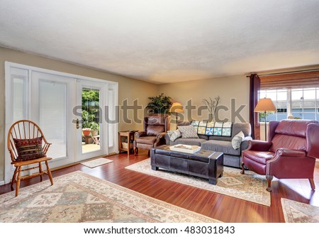 Traditional living room interior with fireplace, hardwood floor and rug. Northwest, USA