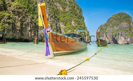 Traditional longtail boat in bay on Phi Phi Island, Krabi,Thailand beach, Phuket - stock photo