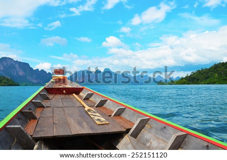 Traditional longtail boat in the sea at Phi Phi Leh Island, Krabi, Southern of Thailand - stock photo