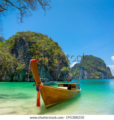 Traditional longtail boat near tropical island, Thailand