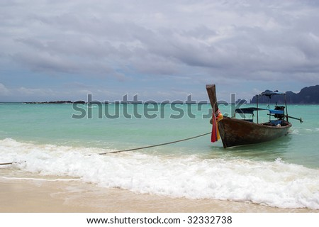 traditional longtail boat on the andaman sea thailand phuket