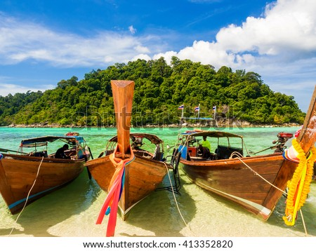 Traditional longtail wood boats in Lipe island locate on Stun province, Thailand - stock photo