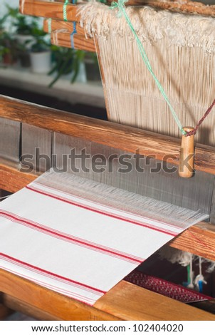 Traditional Loom machine at work - stock photo