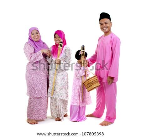 traditional malay family during hari raya occaion - stock photo