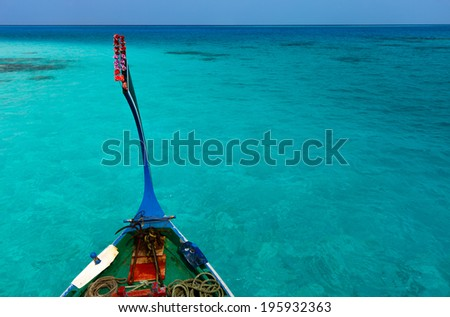 Traditional maldivian boat dhoni in a tropical ocean