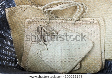 Traditional Maori kite (bag) woven from harakeke (flax). - stock photo
