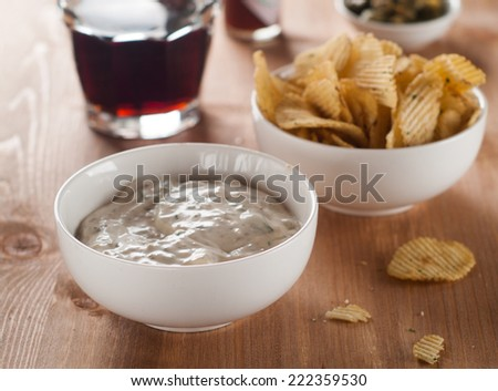 Traditional mayonnaise dip with potato chips and beer, selective focus  - stock photo