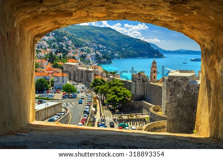 Traditional Mediterranean houses with red tiled roofs and Dubrovnik fortress bastions,Dalmatia,Croatia,Europe - stock photo
