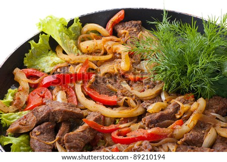 traditional mexican beef fajitas on white background - stock photo