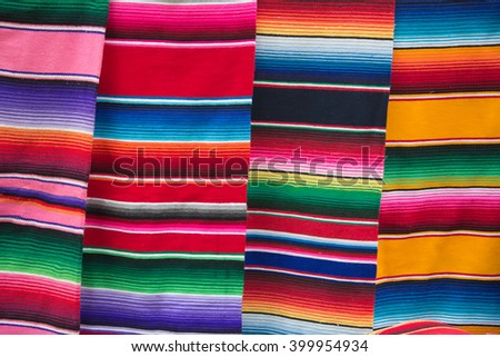 Traditional mexican bright stripped fabric on the market - stock photo