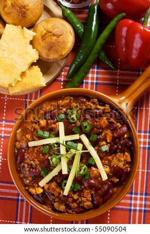 Traditional mexican chili beans con carne served with corn bread - stock photo