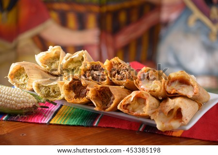 Traditional Mexican food tamales platter with corn with copy space - stock photo