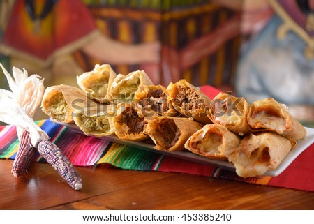 Traditional Mexican food tamales platter with red corn with copy space - stock photo