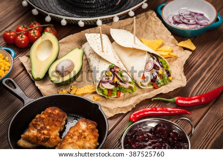 Traditional mexican tortilla wrap with a mix of ingredients - stock photo