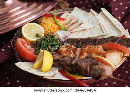 Traditional Middle Eastern skewered meats, lamb,beef and chicken with pita bread