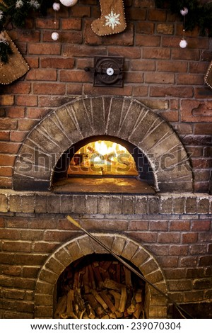 Traditional modern ovens for cooking and baking pizza, a burning fire in the oven - stock photo