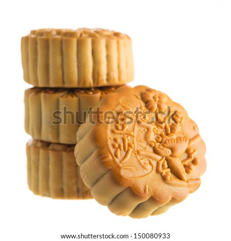 Traditional mooncakes isolated on white background. Chinese mid autumn festival foods. The Chinese words on the mooncakes means red bean paste, not a logo or trademark.