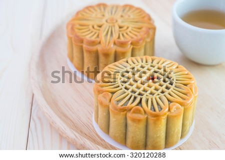 Traditional mooncakes on wooden dish, Selective focus. Chinese mid autumn festival foods.  - stock photo