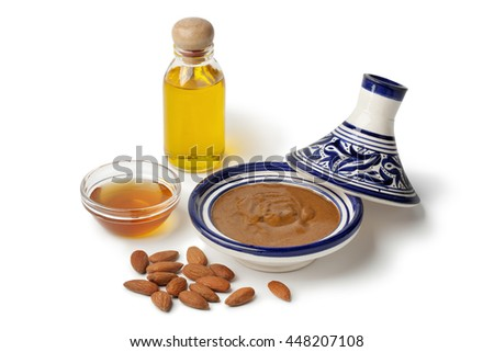 Traditional Moroccan almond amlou with,almonds,argan oil and honey on white background