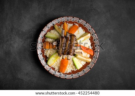 Traditional Moroccan couscous dish with lamb ribs and vegetables. Using this image you can promote restaurant services - stock photo