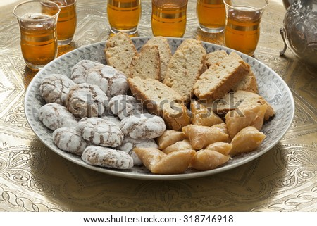 Traditional Moroccan homemade cookies with tea - stock photo