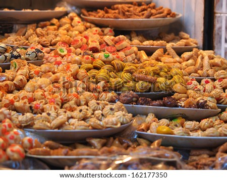 Traditional moroccan sweets on sale at Marrakesh market         - stock photo