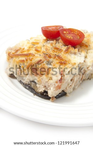 Traditional moussaka under white bechamel sauce and cheese gratin. Greek cuisine.