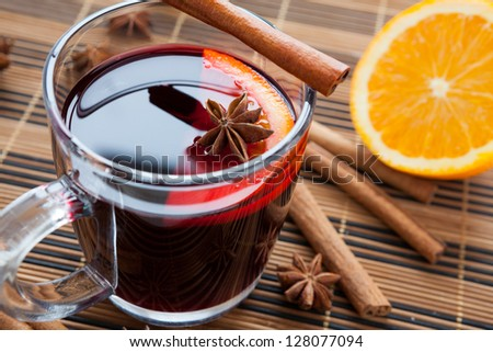 Traditional mulled wine with spices and citrus. , closeup - stock photo