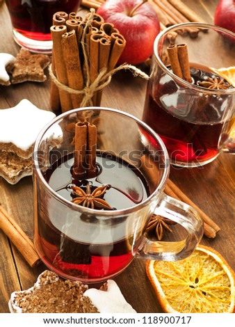 Traditional mulled wine with spices and cookies. Shallow dof.