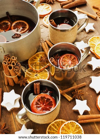 Traditional mulled wine with spices and fruits. Shallow dof. - stock photo