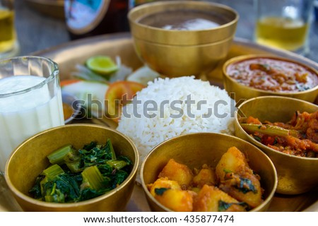 Traditional Nepalese thali in a restaurant - stock photo