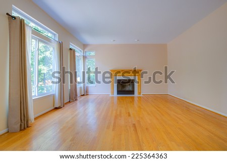 Traditional North America Single Family House Normal Empty Family Room with Fireplace Hardwood Floor Blank Wall Residential Home Interior