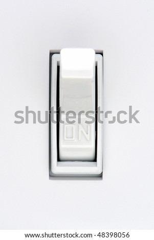 Traditional North American toggle electric light switch in ON position