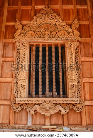 Traditional northern Thai style church window  - stock photo