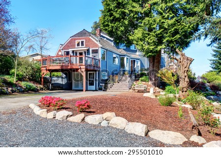 Traditional northwest home with stained deck and path walkway. - stock photo