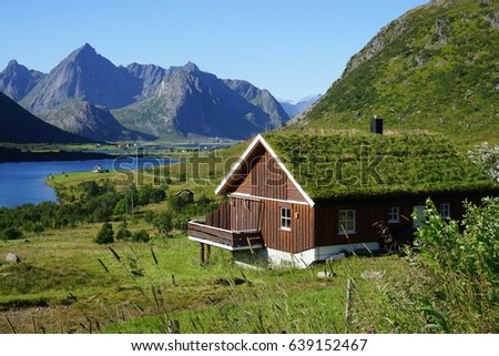 Traditional Norwegian house with a sod roof covered with turf grass