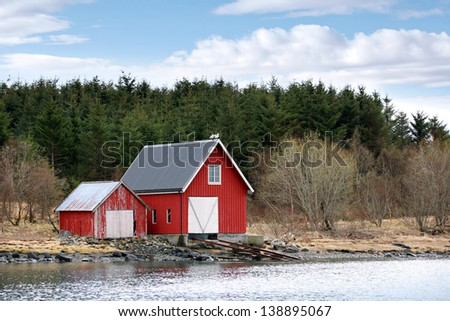 Traditional Norwegian red wooden barns on the sea coast
