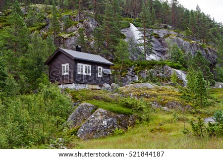 Traditional norwegian wooden house with solar panels in Norway mountains