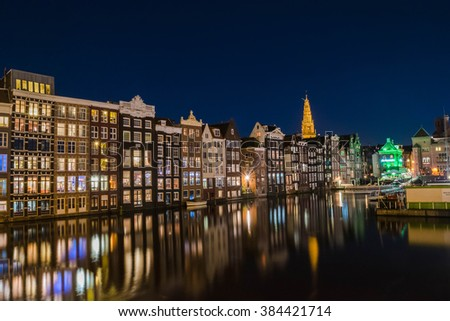 Traditional old buildings in Amsterdam at night, Holland, Netherlands