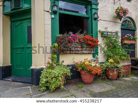 Traditional old English public house with summer flowers.
